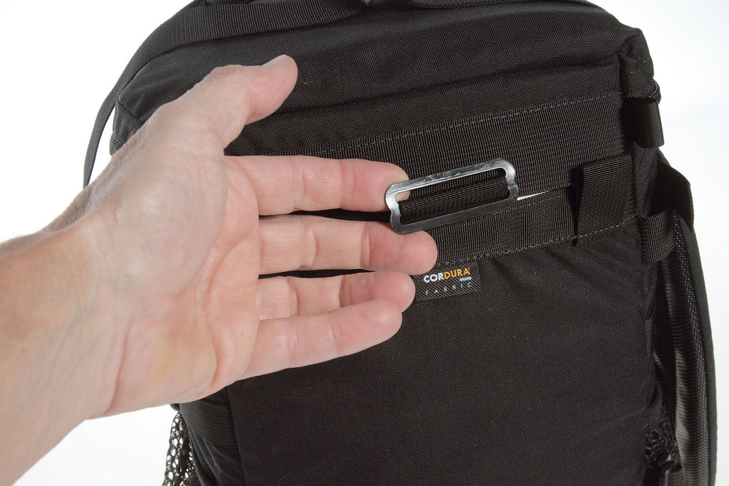 Hidden under a piece of webbing is a metal slider, for which a backpack harness attaches.