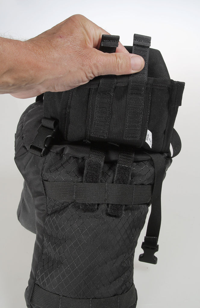 The Velcro tabs on the back of a pouch slide through the MOLLE-webbing for piggy-backing to the sack.
