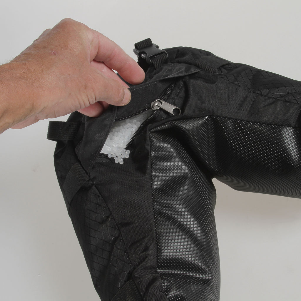 A covered zippered opens to allow filling or emptying of fill.