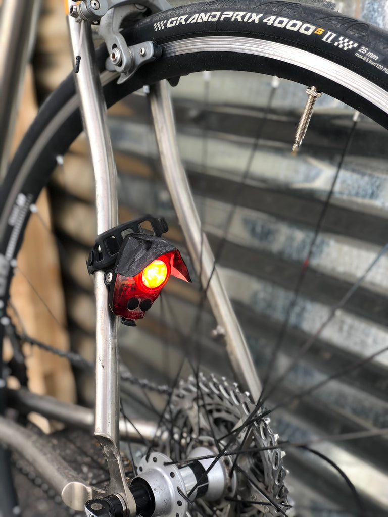 Example of the recommended location for  a tail light: attached to a seatstay, instead of on the seatpost or directly to a bag.