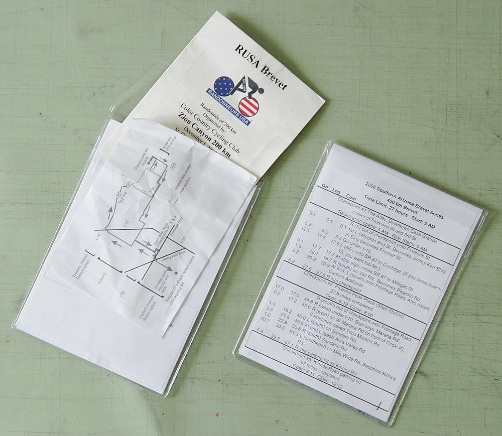 The pouch will hold 6-7 pages including cue sheets, brevet cards, maps & a pencil.