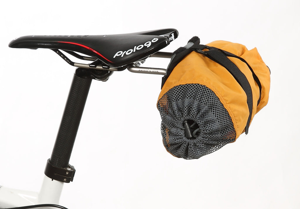 A reasonably sized stuff sack can attach directly to the bracket w/o the use of a saddlebag.