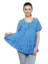 Loose fitting peasant top with stitching along the neckline and hem.