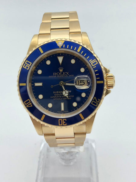 Rolex Submariner Date Yellow Gold K serial mint box and papers Pre-Owned 2002 16618