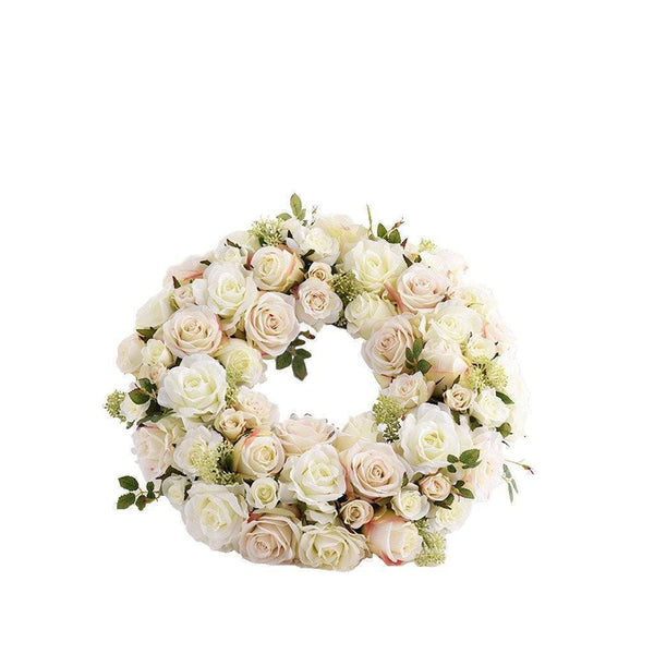 a wreath floral art composed of white roses