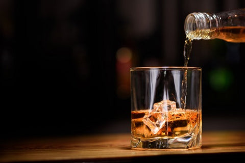 whiskey in to glass image
