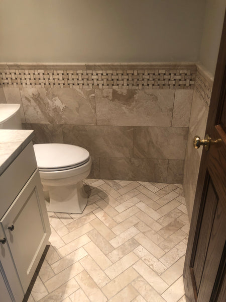 Powder Room with Marble Herringbone Floor & Wainscoting