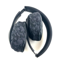 Load image into Gallery viewer, Black Camo Mufz. These covers help protect against sweat and dirt. It also allows you to personalize your headphones.