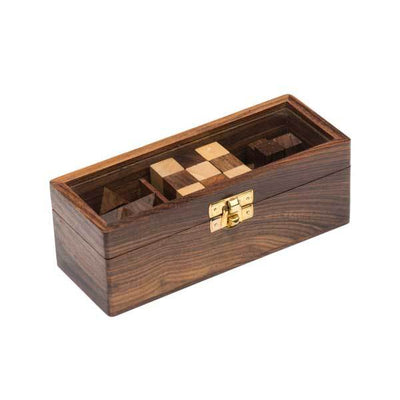 Our handcrafted novelty puzzle set features three unique challenges in rich muli-tone Indian Rosewood, complete with glass top wooden box for tasteful display and storage.