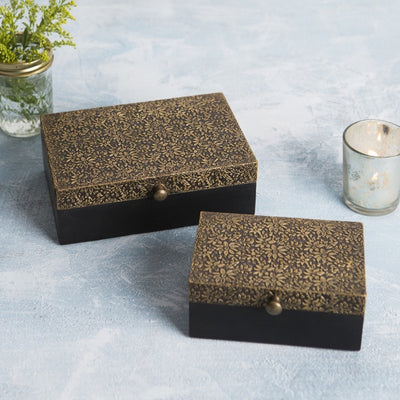 Beautiful wooden boxes with ornately carved golden metal lid crafted by artisans skilled in metal engraving and embossing.