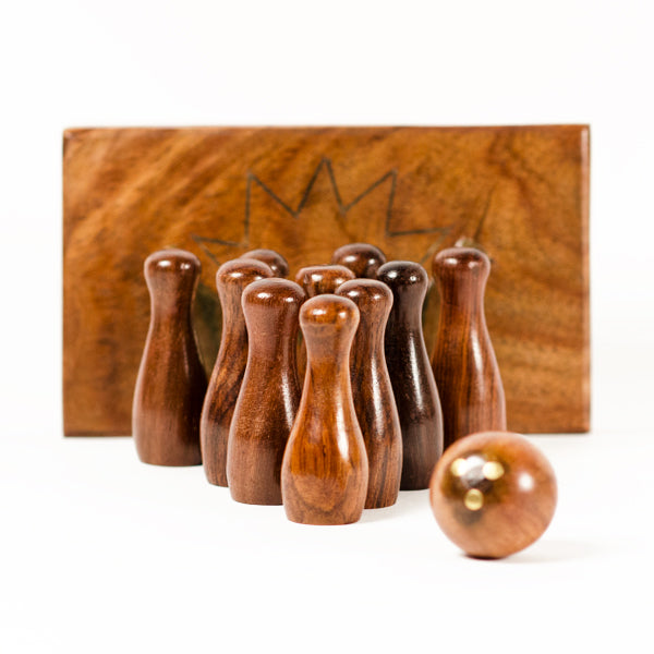 Sleek and unique mini-bowling game carved from responsibly harvested Indian Rosewood
