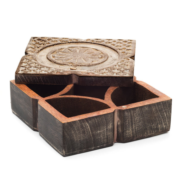 This sustainably harvested, square mango wood pivot box was inspired by traditional shapes of antique Indian spice boxes.