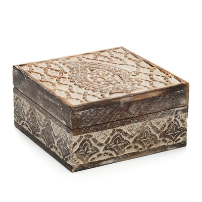 This ethically sourced mango wood jewelry box with hand carved Indian motifs and white rub finish has the feel of an heirloom collected in the bustling markets of Delhi or Calcutta.
