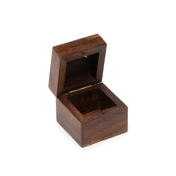 Small box with an intricately carved top styled with a star pattern.
