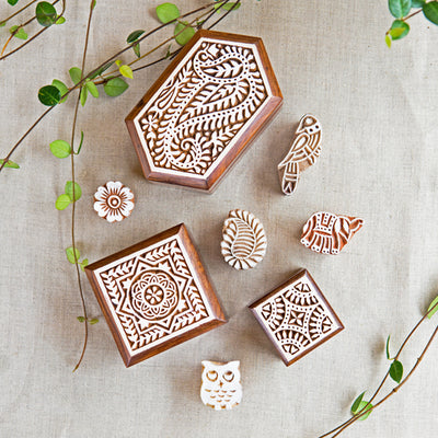 a collection of small boxes intricately carved from sustainably sourced Indian Rosewood and hand painted with a lovely white finish.