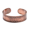 Copper brass, hammered cuff in a matte finish. Larger size to fit men's wrists and malleable for adjustment if needed.