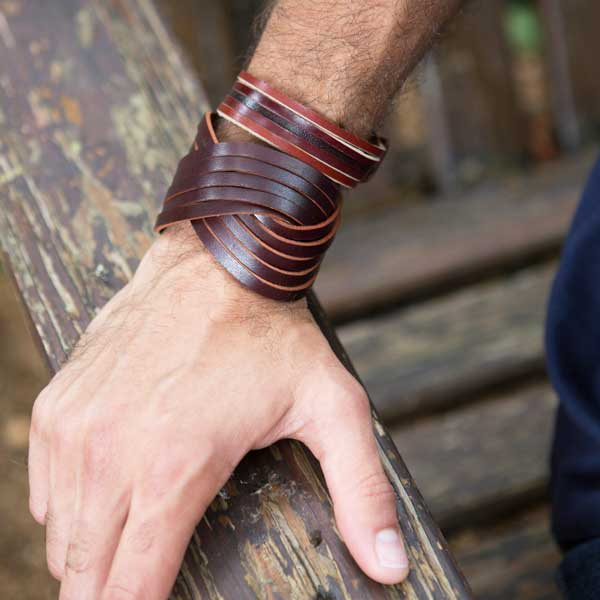 Large woven bracelet crafted from ethically sourced, vegetable tanned leather in rich brown with brass stud accents and dual snap closure.