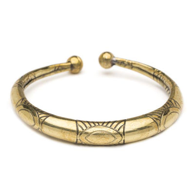 Elegantly designed hollow brass pieces including a surprisingly lightweight brass cuff in gold with embossed Art Deco design