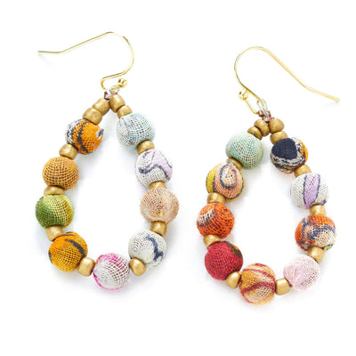 Colorful fabric beads made from recycled Kantha textiles alternate with tiny golden beads on a teardrop shaped wire.