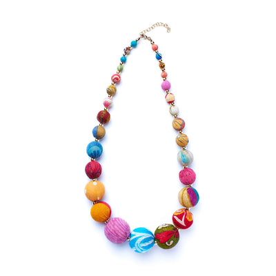 Bold and beautiful, this upcycled necklace makes a statement that you care about who makes your accessories.