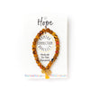 "This repurposed textile bracelet comes with a Hope attribute tag, which reads ""Hope reminds us of our limitless potential for the future."