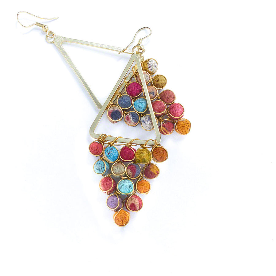 A colorful grouping of recycled Kantha textile beads hangs below a gold triangular frame.