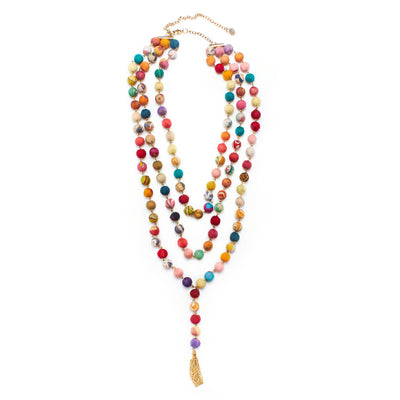 Three strands of recycled Kantha textile beads are linked with gold metal wires and complimented by gold chain fringe hanging from the longest strand.