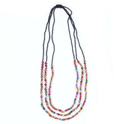 Three strands of colorful Kantha beads alternate with black seed beads for a casual, already-layered-for-you silhouette.
