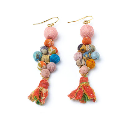 One large Kantha bead tops a colorful cluster of Kantha textile beads, finished with a hanging frayed fabric tassel.
