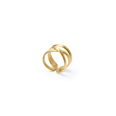 A modern ring wraps and then crisscrosses at the center to create a bold silhouette.
