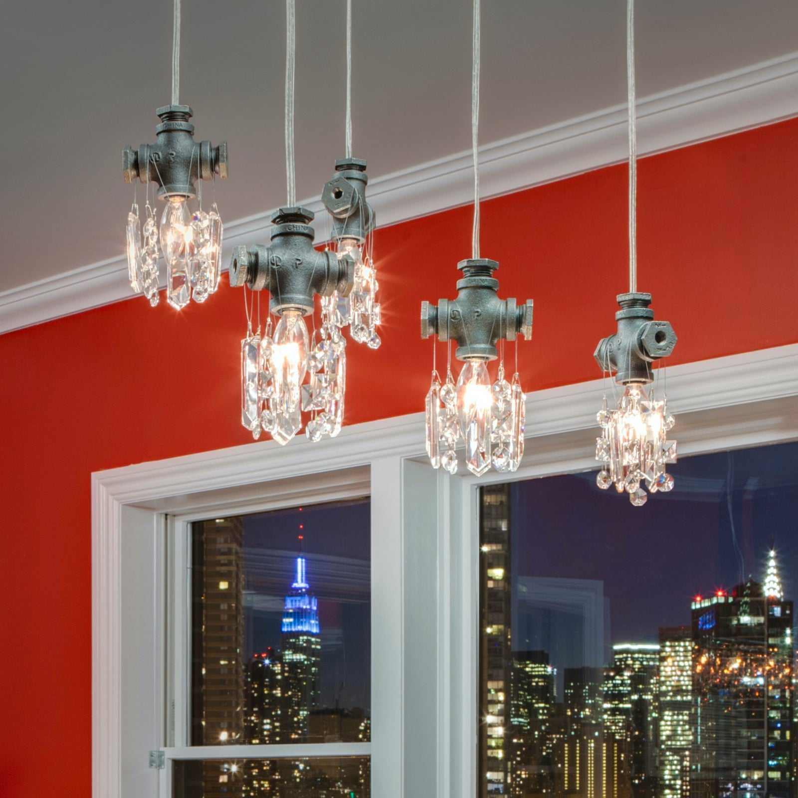 A cluster of Tribeca Single-Bulb Chandelier Pendants