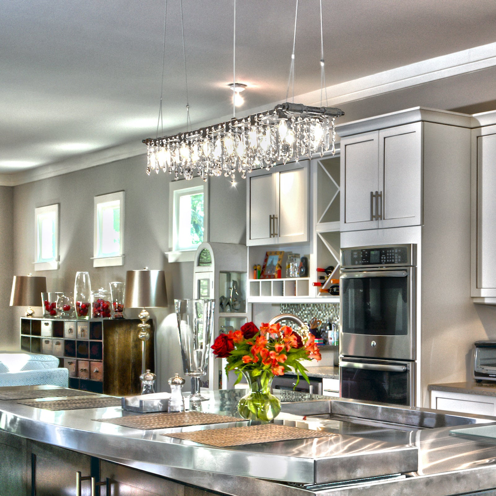 A Tribeca Banqueting Chandelier over a kitchen island