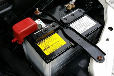 Close up of car battery showing that Bowen Taxi gives car boosts.