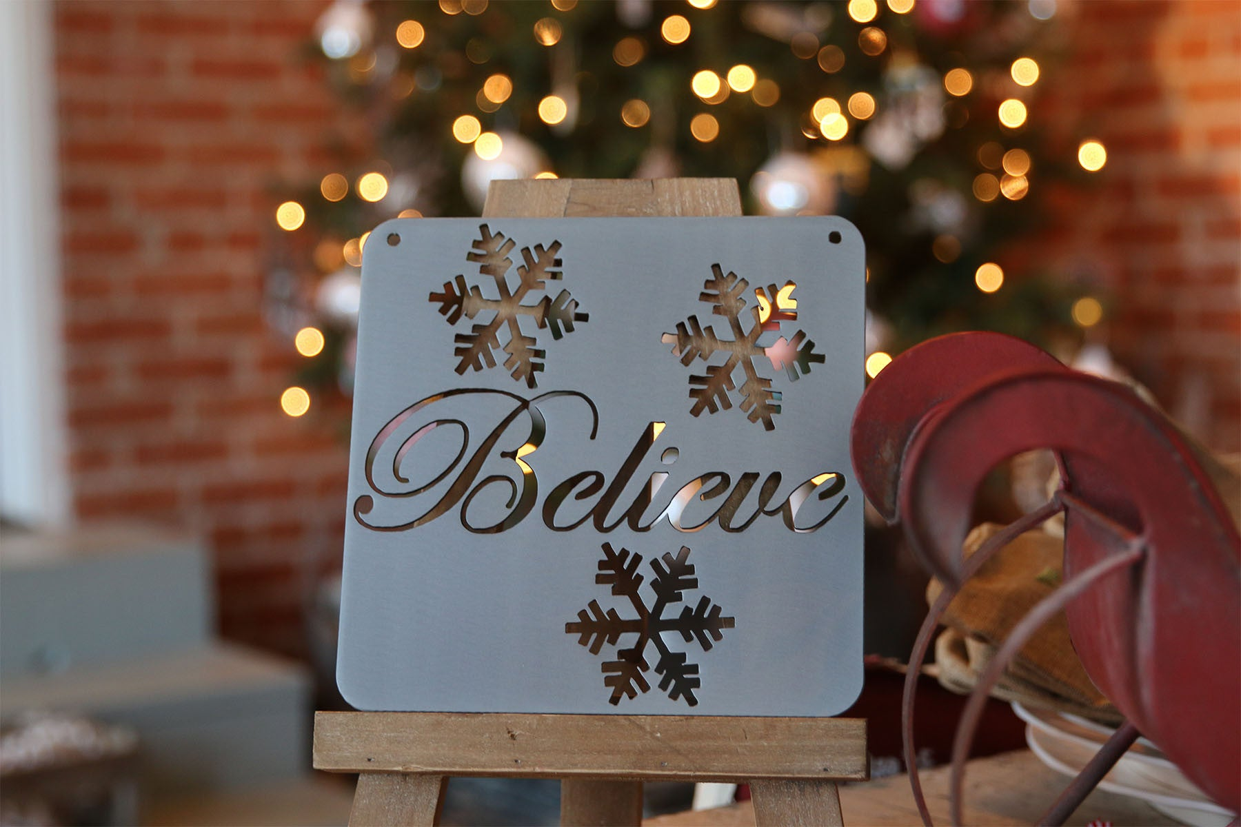 believe christmas sign with snowflakes believe christmas sign with snowflakes