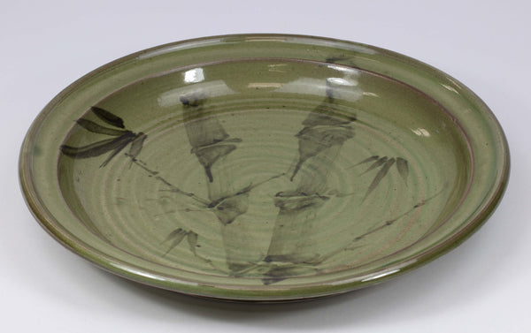Beautiful, durable porcelain dinner plate in a hand-painted bamboo pattern and translucent glaze. 10 3/4-inch diameter, chip-resistant, oven- and dishwasher-safe. Each piece is unique--shape, size and color will vary.