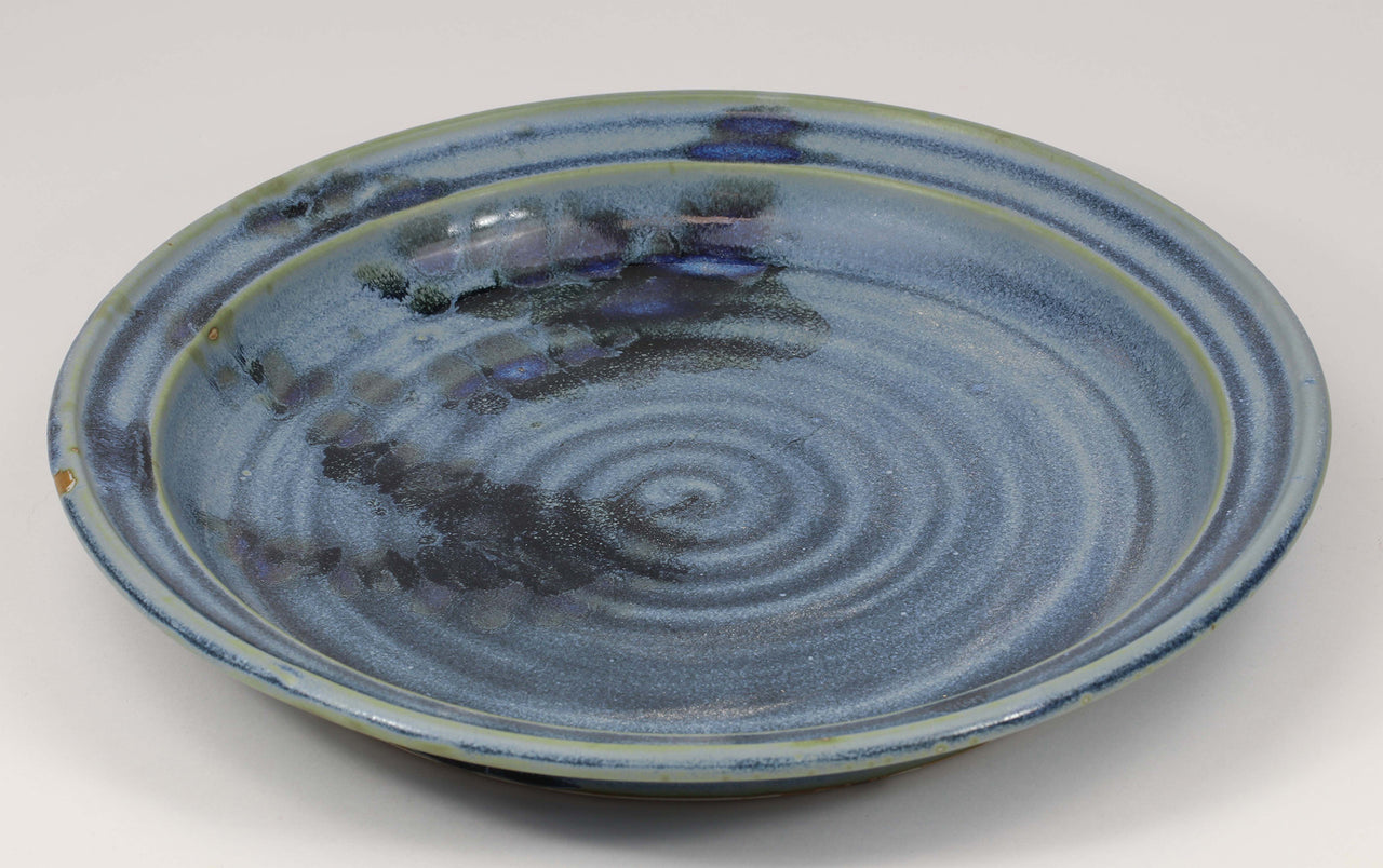 Beautiful, durable porcelain dinner plate in a subtle leaf-printed botanical pattern and striking glaze colors. 10 3/4-inch diameter, chip-resistant, oven- and dishwasher-safe. Each piece is unique--shape, size and color will vary.