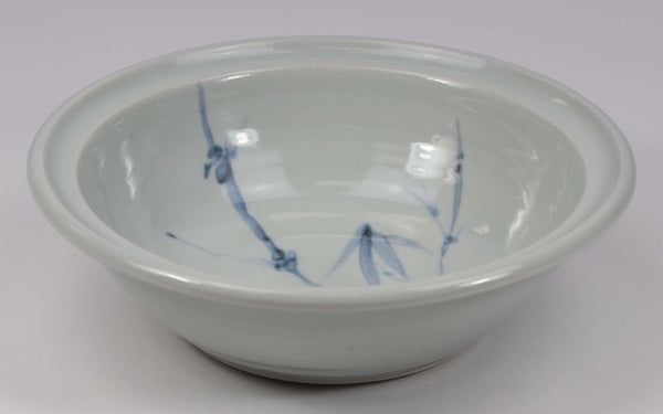 Beautiful, durable porcelain large bowl in a hand-painted bamboo pattern and translucent glaze. Approximately 24 ounces in volume, chip-resistant, oven- and dishwasher-safe. Each piece is unique--shape, size and color will vary.