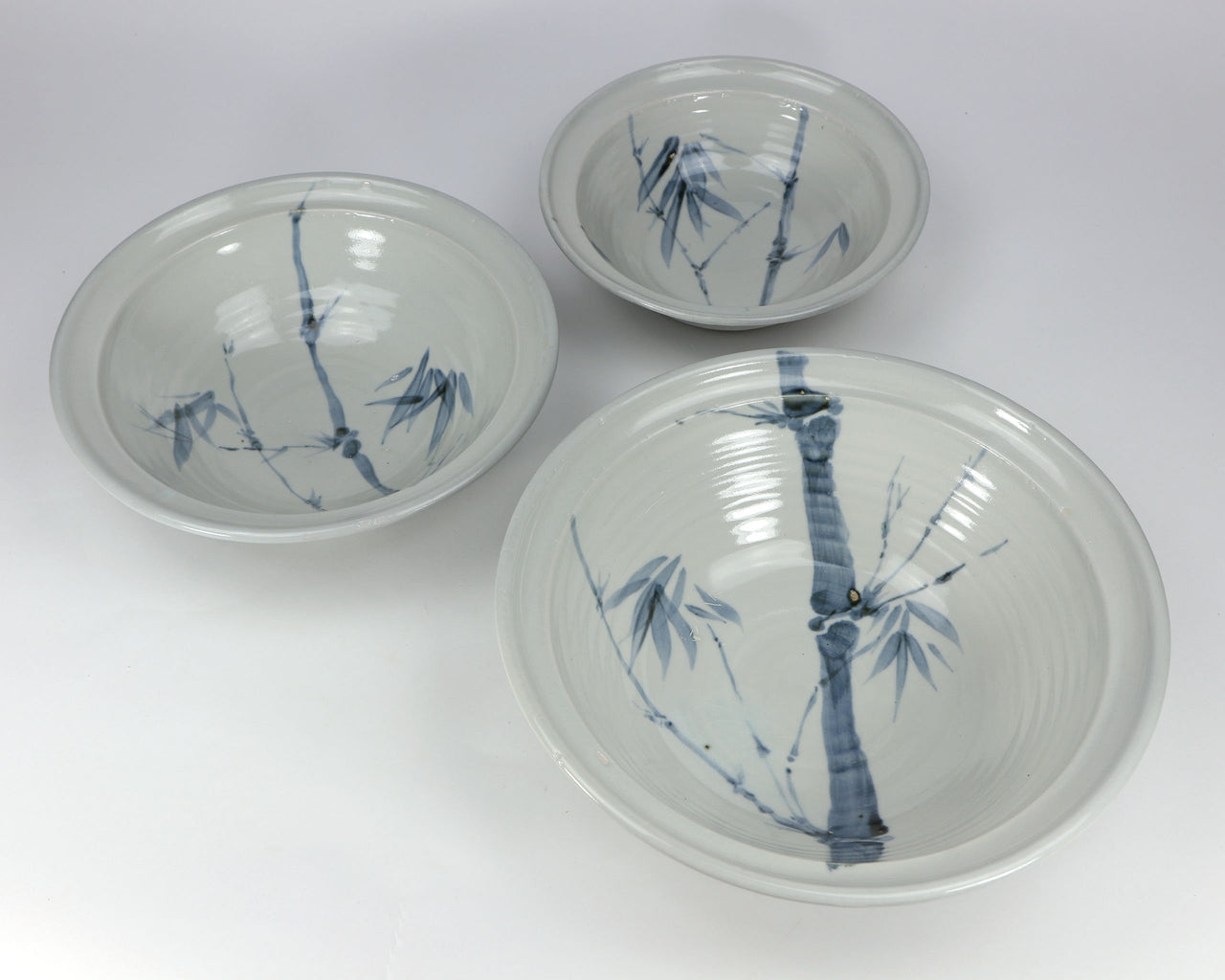 3-piece porcelain serving bowl set in a hand-painted bamboo pattern and translucent glaze. Approximately 26 ounces in volume, chip-resistant, oven- and dishwasher-safe. Each piece is unique--shape, size and color will vary.