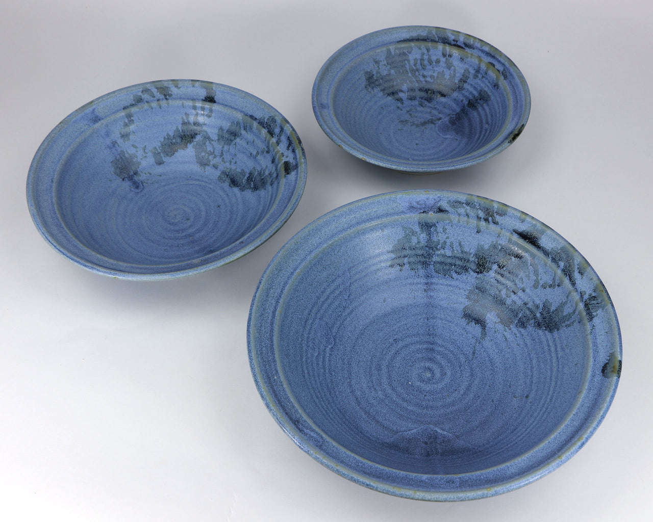 3-piece porcelain serving bowl set in a subtle leaf-printed botanical pattern and striking glaze colors. Approximately 26 ounces in volume, chip-resistant, oven- and dishwasher-safe. Each piece is unique--shape, size and color will vary.