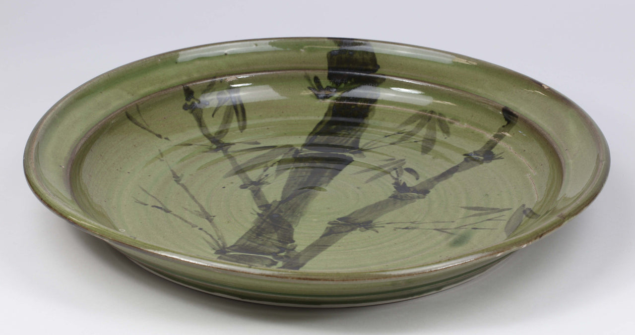 Beautiful, durable porcelain serving platter in a hand-painted bamboo pattern and translucent glaze. Approximately 13-inch diameter, chip-resistant, oven- and dishwasher-safe. Each piece is unique--shape, size and color will vary.