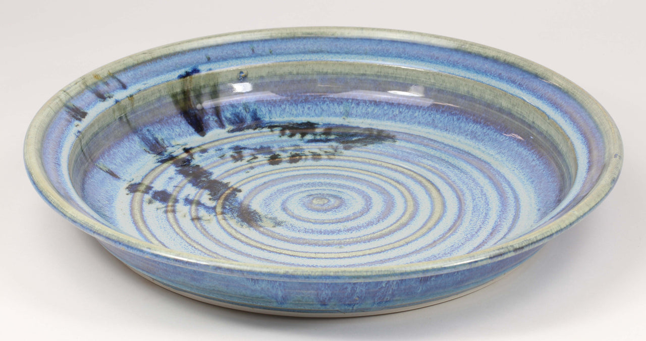 Beautiful, durable porcelain serving platter in a subtle leaf-printed botanical pattern and striking glaze colors. Approximately 13-inch diameter, chip-resistant, oven- and dishwasher-safe. Each piece is unique--shape, size and color will vary.