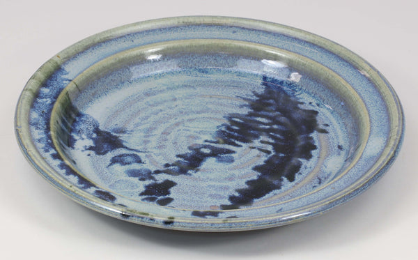 Beautiful, durable porcelain small plate in a subtle leaf-printed botanical pattern and striking glaze colors. 8 1/2-inch diameter, chip-resistant, oven- and dishwasher-safe. Each piece is unique--shape, size and color will vary.