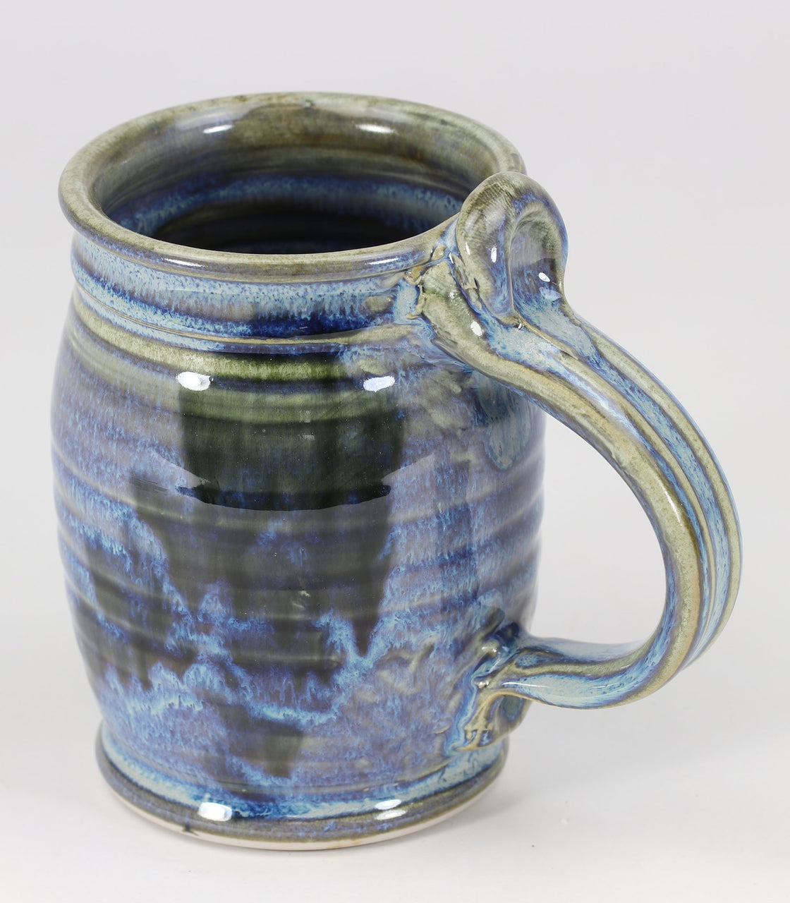 Beautiful, durable large porcelain mug in a subtle leaf-printed botanical pattern and striking glaze colors. Ideal size for a cold beer or a cozy morning cup of coffee. Mugs are chip-resistant and dishwasher-safe. Each piece is unique--shape, size and color will vary.