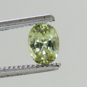 1.1 cts Yellow sapphire faceted 5 x 7 mm oval Dry Creek, Montana