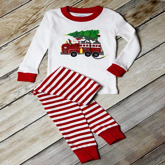 e8a18d764 Fire truck santa pajamas – Sawyer and Sisters Smocked Clothing and More