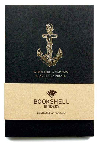 Bookshell Bindery A6 travel notebook with gold foil quote Work like a captain play like a pirate with anchor illustration on the cover