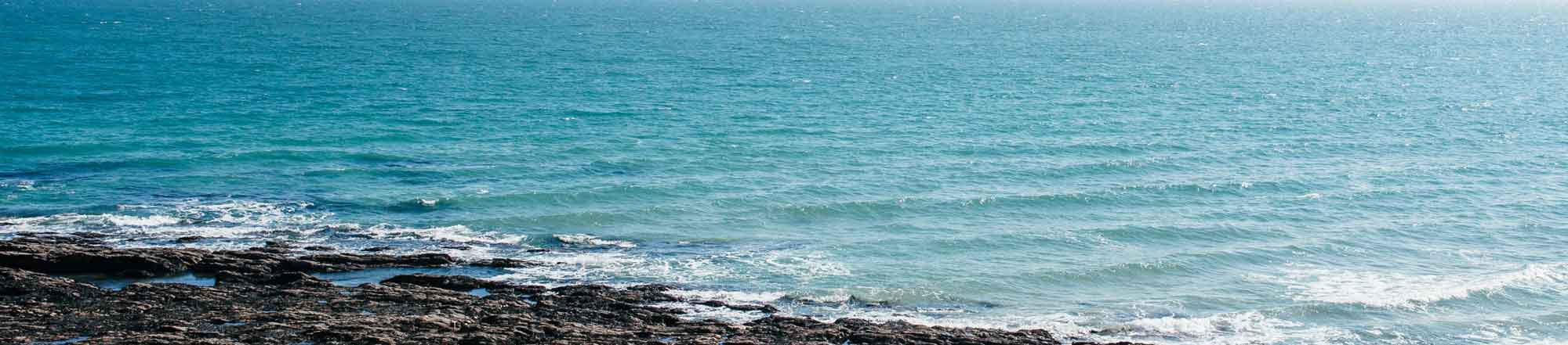 How Coronabirus is affecting Bookshell Bindery, image of the beautiful blue sea at Gylly beach in Falmouth, Cornwall