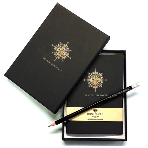 Black A6 pocket notebook and pencil with matching gift box, with gold foiled compass illustration