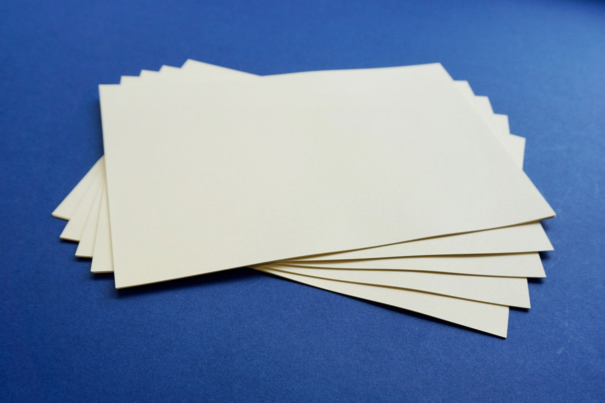 Cream plain A5 paper for bookbinding short grain from Bookshell Bindery