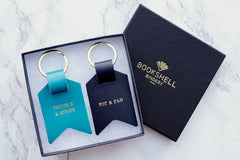 Couple keychain from Bookshell Bindery in turquoise blue leather and black leather, Trouble and strife (wife), Pot and pan (Old man)